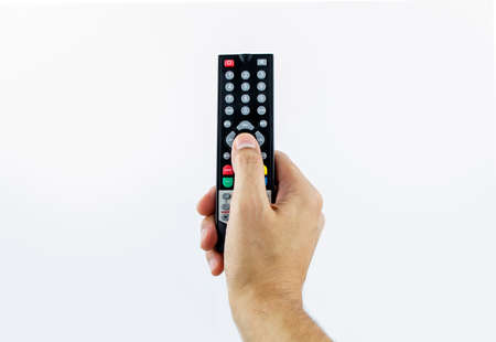 Hand holding television remote photo