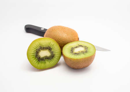Two Kiwis fruits and knife with white background photo
