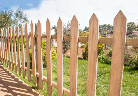 abreast: close up of wooden fence and grass