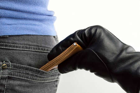 close up of a the hand of a thief stealing the money to a woman