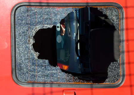 triplex: broken glass from a car after impact Stock Photo