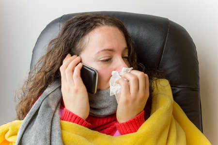 persons: sick woman doctor urgently calling Stock Photo