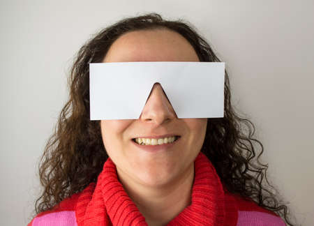 meaningless: smiling woman with paper glasses concept of meaningless smile and copy space Stock Photo