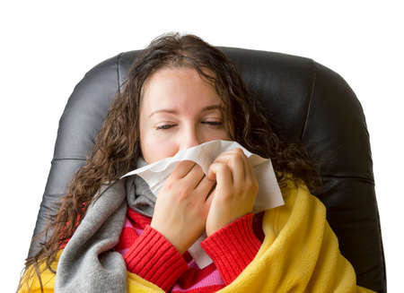 Sick woman flu caught cold  sneezing into tissue photo