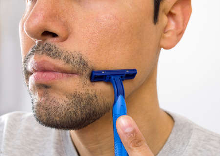 closeup of the face of a man shaving photo