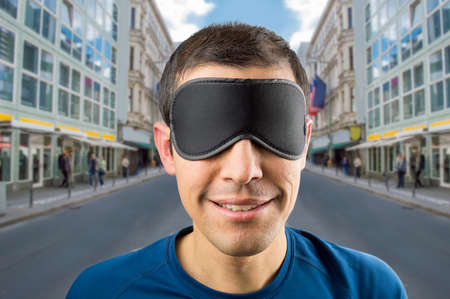 happens: man is happy without knowing what happens in the world blind metaphor Stock Photo