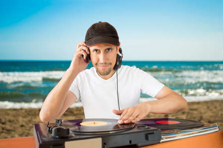DJ  vinyl record on a  turntable with beach  background Stock Photo - 26719796