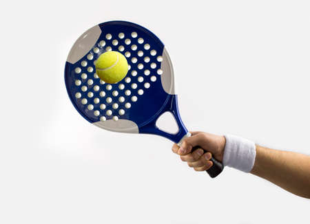 hand with a tennis racket hitting a ball paddle Stock Photo