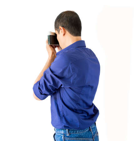 man photographing with camera isolated over white background