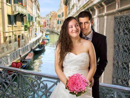 Newly married in Venice in bridge photo