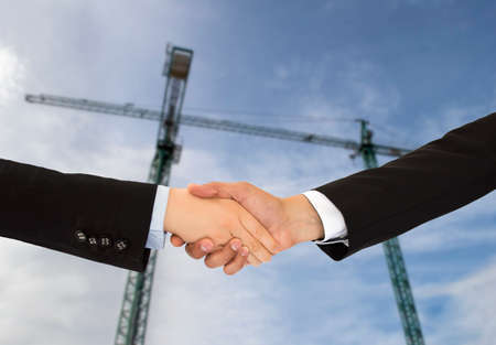 close up of construction deal with handshake photo