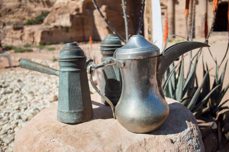 dallah is a metal pot with a long spout designed specifically for making Arabic coffee photo