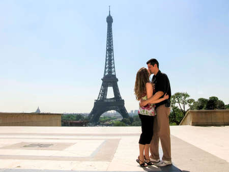 couple kissing in Paris on their honeymoon with copyspace photo