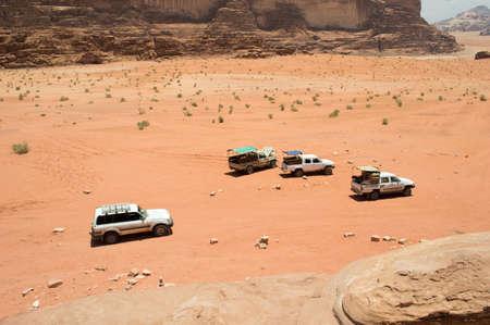 Off road vehicles driving in the wadi rum desert from jordan