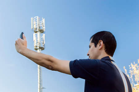 man displeased by getting no signal on his phone Stock Photo