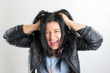 women pulling their hair very extresada because of bad music photo