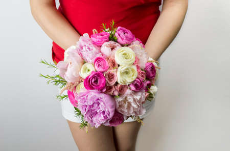 woman showing a bouquet of peonies medium bodied photo