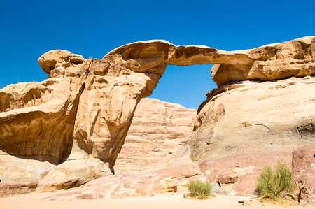 rock arch: View through a rock arch in the desert of Wadi Rum Jordan