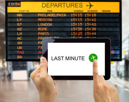 minute: man search for last minute deals at an airport with your tablet