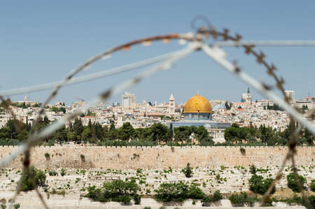 jewish conflicts in Jerusalem. Rock Dome on the Temple Mount in Jerusalem in Israel with behind wired fence photo