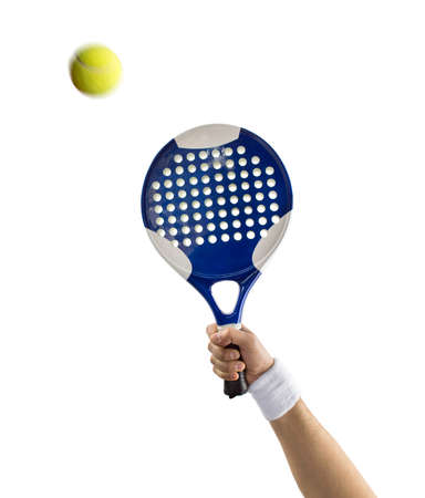 hand with a tennis paddle racket hitting a ball with background white photo