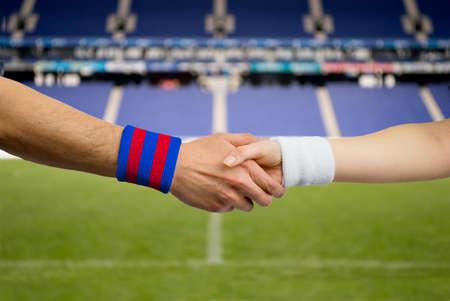close up handshake of spanish match between Barcelona and Madrid Reklamní fotografie