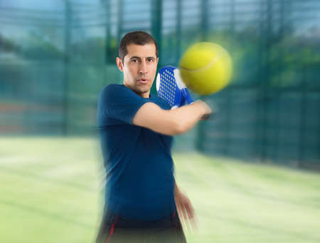 close up of paddle tennis player in zoom effect photo