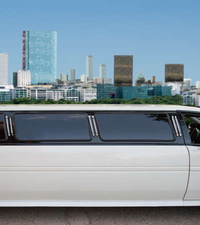 white limousine crossing the city with the skyscrapers buildings on the background photo