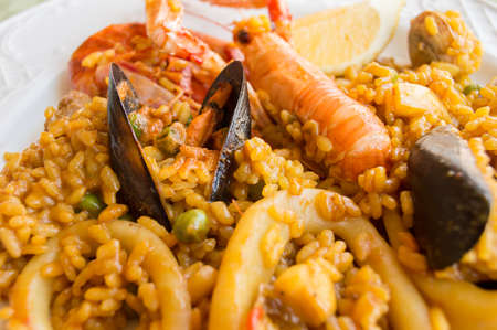 close up a traditional spanish rice paella with sea food photo