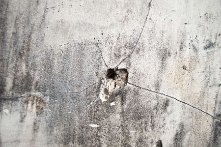 A closeup image of a bullet hole photo