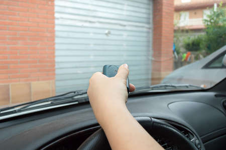 car door: pressing remote control to enter the car park Stock Photo