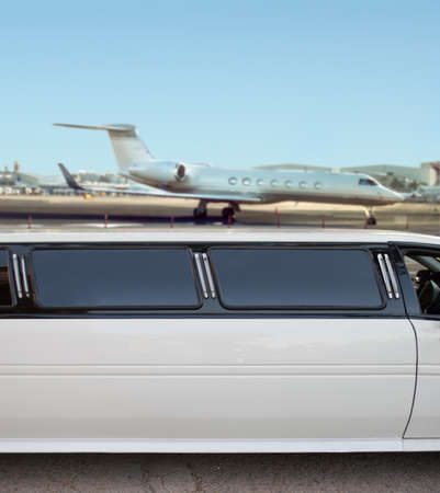 landing strip: white limousine and private jet on landing strip