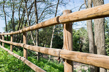 delimitation: wooden fence and blue sky background