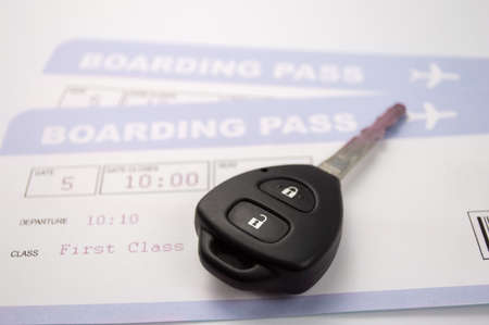 rental car: close up of key rental car and airline boarding pass Stock Photo