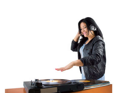 dubstep: female DJ spinning records in headphones with white background Stock Photo