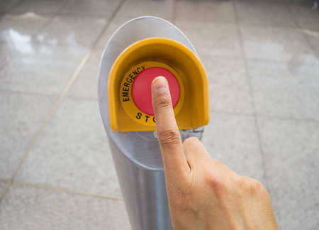 panicked: Hand pushing red emergency stop button Stock Photo
