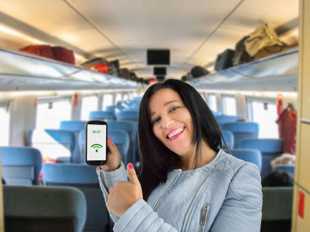 thumbsup: woman showing her phone and thumbs up and connected to wifi train