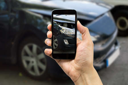 car wreck: Man photographing his veiculo damages for accident insurance Stock Photo