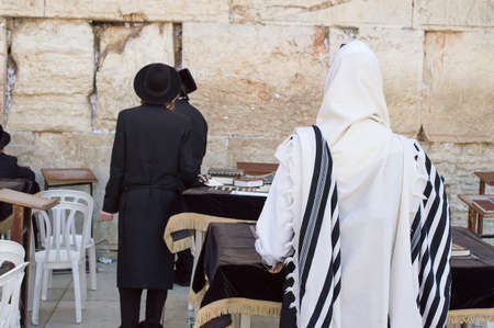 mishnah: Jerusalem, Israel - May 23 , 2014: Jewish worshipers pray at the Wailing Wall in Jerusalem