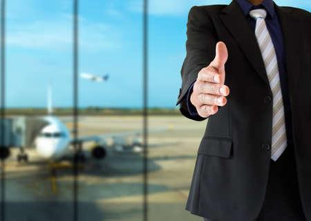 aeroplane: handshake and welcoming airport