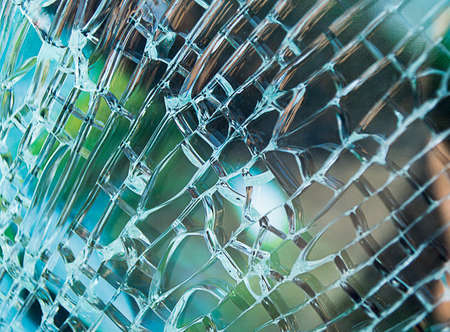 smithereens: Detail of glass window car cracked by an accident