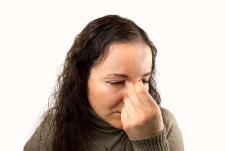 eyestrain: tired and eyestrain woman with white background