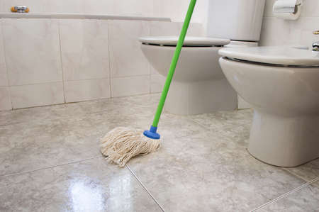 scrubbing: scrubbing the bathroom floor Stock Photo