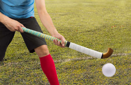 sportsperson: men battle for control of ball during field hockey game Stock Photo