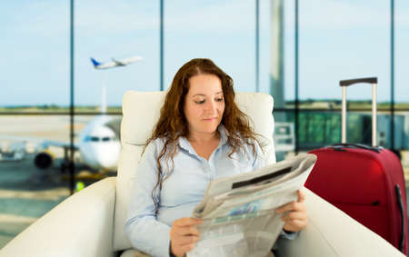 commenting: woman commenting economy news in vip zone aiport