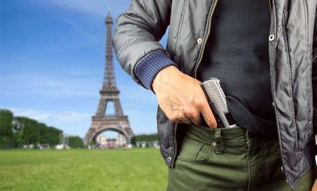 gunman: close up of gunman in the Elysian fields in Paris