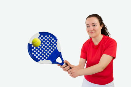 sportsperson: portrait of a  girl paddle tennis player standing and swatting the ball