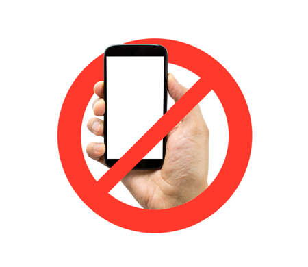 phone ban: hand on a no mobile phones sign isolated in white background Stock Photo