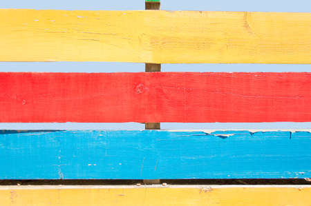 delimitation: detail of wooden fence painted in colors in horizontal Stock Photo
