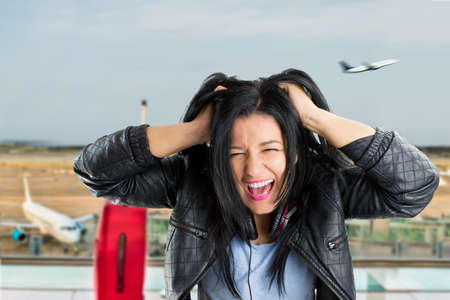 angry: woman pulling their hair and angry because I missed the plane Stock Photo